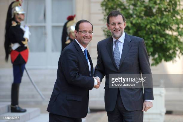 French President Francois Hollande welcomes Spanish Prime Minister Mariano Rajoy at Elysee Palace on May 23 2012 in Paris France Rajoy will then go...