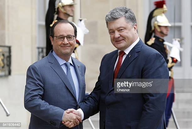 French President Francois Hollande welcomes Ukrainian President Petro Poroshenko prior to attend a meeting at the Elysee Presidential Palace on June...