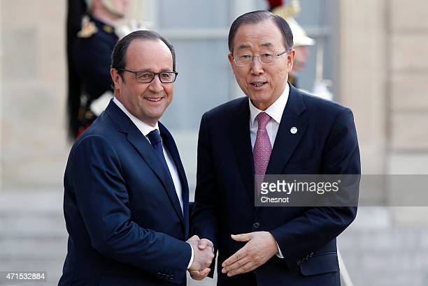 French President Francois Hollande welcomes United Nations Secretary-General Ban Ki-Moon prior to a meeting at the Elysee Palace on April 29, 2015 in...