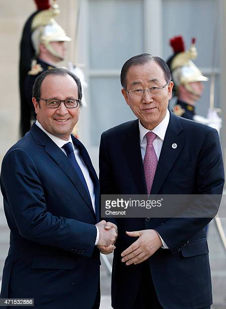 French President Francois Hollande welcomes United Nations SecretaryGeneral Ban KiMoon prior to a meeting at the Elysee Palace on April 29 2015 in...