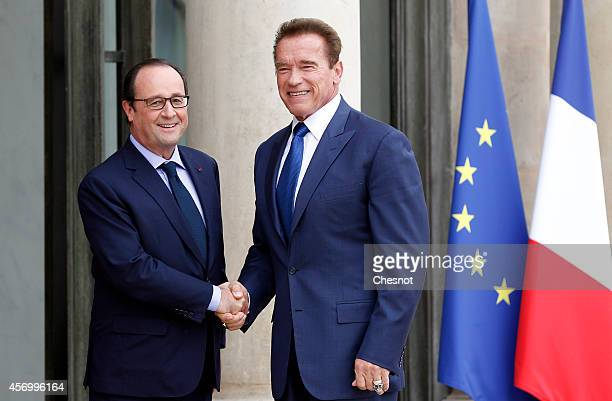 French President Francois Hollande welcomes US actor former governor of California and founding chair of the R20 initiative Arnold Schwarzenegger...