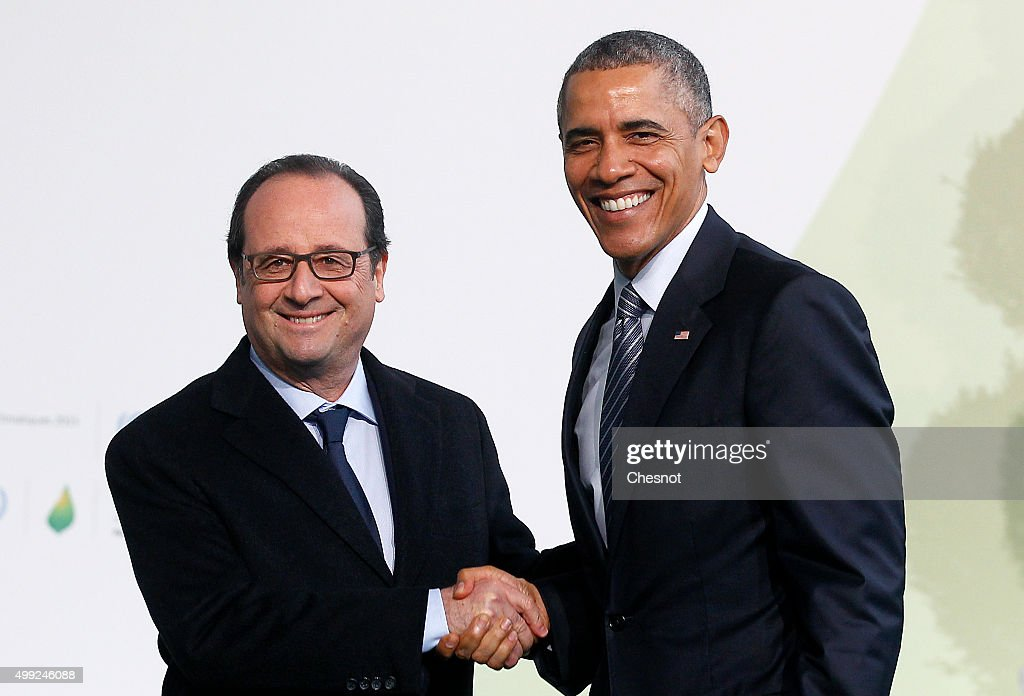 French President Francois Hollande (L) welcomes US President Barack Obama as he arrives for the COP21 United Nations Climate Change Conference on November 30, 2015 in Le Bourget, France. More than 150 world leaders are meeting for the 21st Session of the Conference of the Parties to the United Nations Framework Convention on Climate Change (COP21/CMP11), from November 30 to December 11, 2015