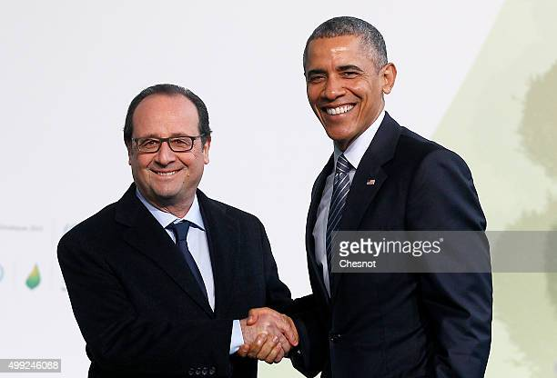 French President Francois Hollande welcomes US President Barack Obama as he arrives for the COP21 United Nations Climate Change Conference on...