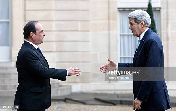 French President Francois Hollande welcomes US Secretary of State John Kerry prior to a meeting at the Elysee Presidential Palace on November 17 2015...