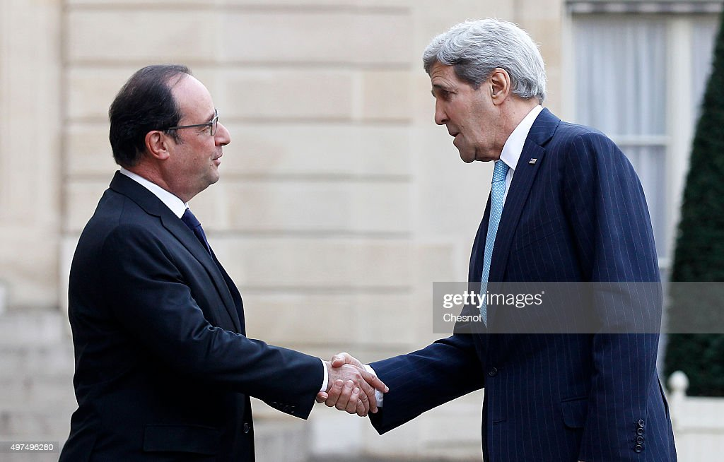French President Francois Hollande (L) welcomes US Secretary of State John Kerry prior to a meeting at the Elysee Presidential Palace on November 17, 2015 in Paris, France. John Kerry arrives in Paris to pay tribute to victims of last week's terrorist attacks.