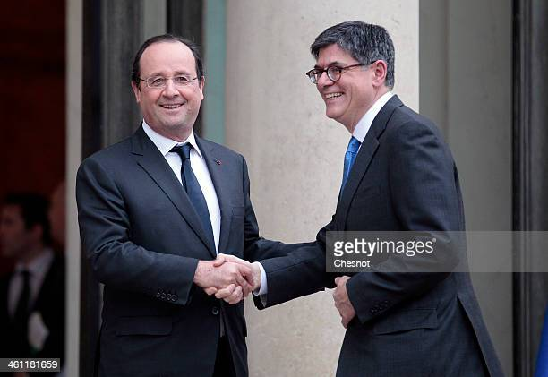 French President Francois Hollande welcomes US Treasury Secretary Jack Lew at the Elysee Palace on January 7 2014 in Paris France Jack Lew is on a...