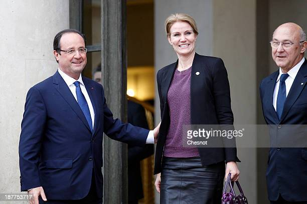 French President Francois Hollande with Labour Employment and Social Dialogue Minister Michel Sapin welcome Danish Prime Minister Helle...