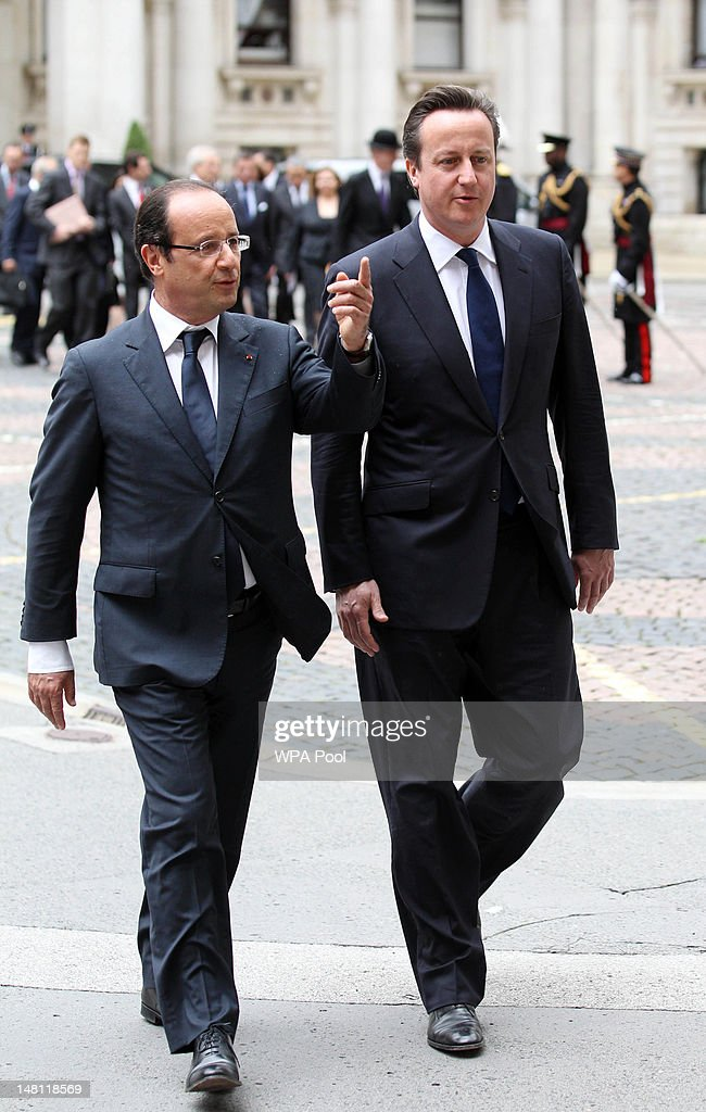 French President Francois Hollande (L) with Prime Minister David Cameron at the Foreign and Commonwealth Office on July 10, 2012 in London, England. This is the French President's first official visit to the United Kingdom since taking office, during which he will attend meetings with British Prime Minister David Cameron and Queen Elizabeth II.