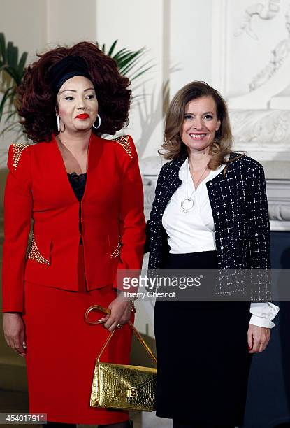 French President Francois Hollande's companion Valerie Trierweiler greets Cameroon's First Lady Chantal Biya at Orsay Museum on December 6 2013 in...