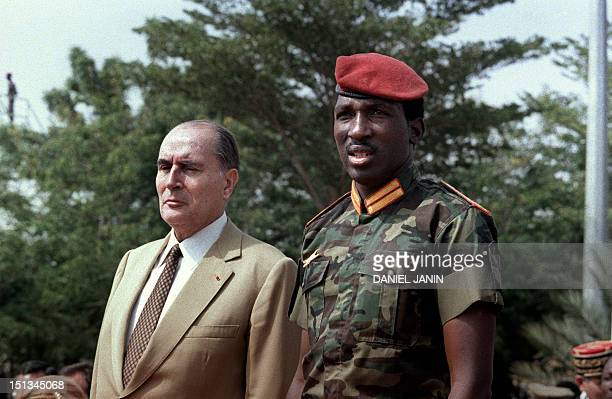 French President Francois Mitterrand and Captain Thomas Sankara President of the Burkina Faso are pictured during the welcome ceremony for Mitterrand...