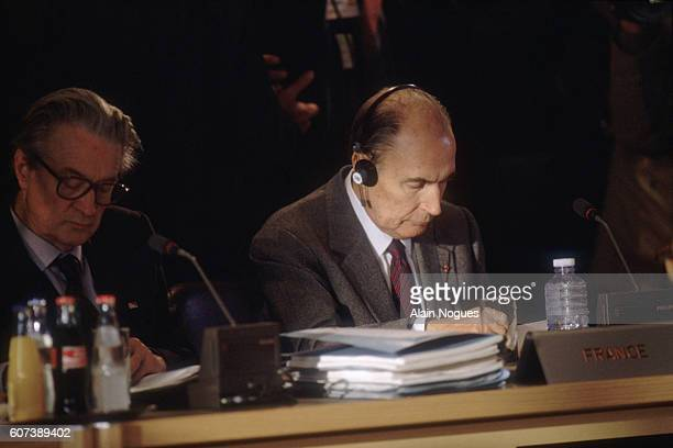 French President Francois Mitterrand and Minister of Foreign Affairs Roland Dumas read documents during the first day of the Maastricht Summit...