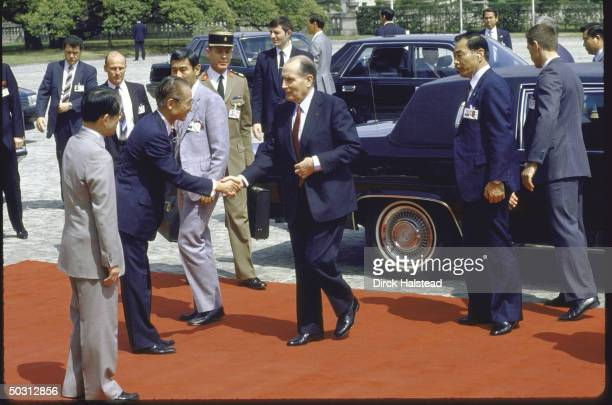 French President Francois Mitterrand arriving at Akasaka Palace with red carpet treatment for Economic Summit