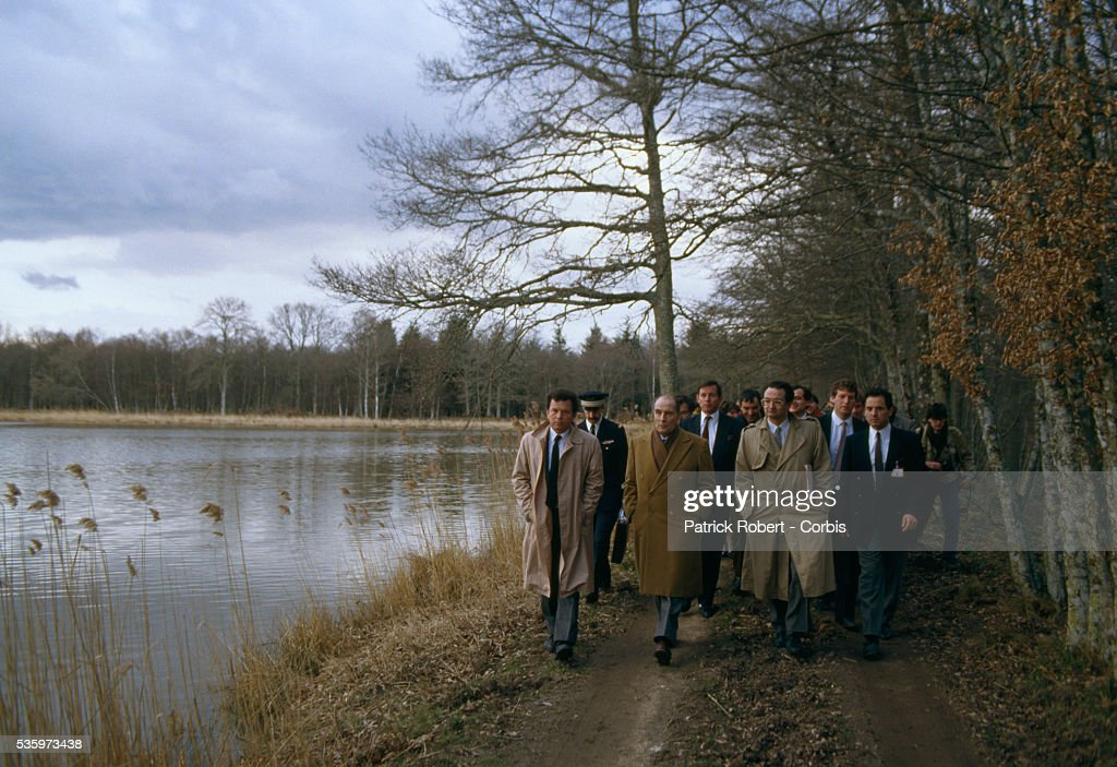French president Francois Mitterrand (second from left) goes for a walk with economist Jacques Attali (second from right) while in Chambord on official business. Mitterrand is preparing to meet with West German chancellor Helmut Kohl.