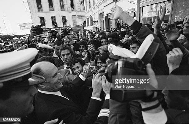 French president Francois Mitterrand greets a crowd in Algiers on the second day of his visit Mitterrand's visit is the second ever made by a French...