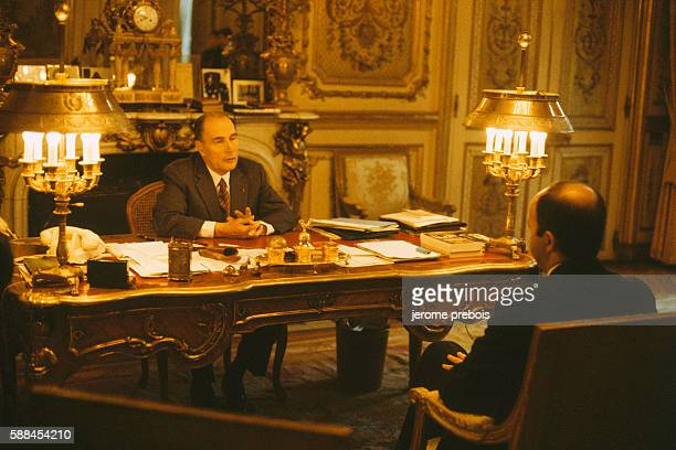 French President Francois Mitterrand in his office at the Elysee Palace during an interview with Prime Minister Laurent Fabius