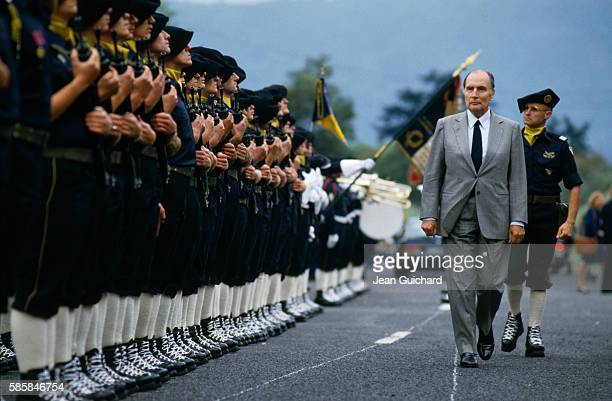 French President Francois Mitterrand is greeted by alpine troops during an official visit to the French region of Savoie