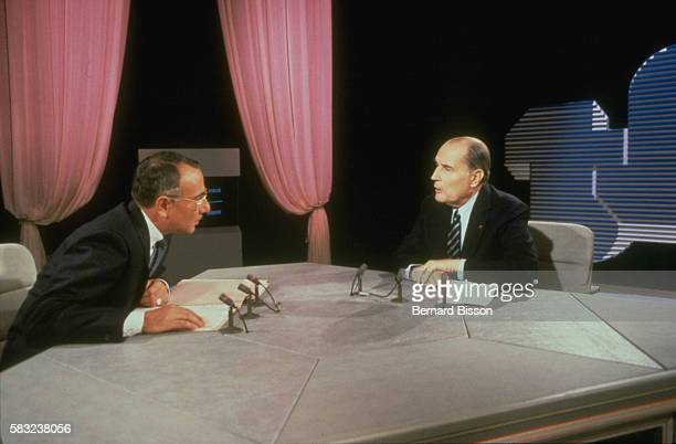 French president Francois Mitterrand is invited by news presenter Yves Mourousi on the set of the TF1 television channel