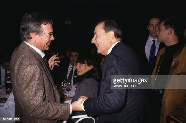 French President Francois Mitterrand with humorist Guy Bedos taking part in a dinner hosted by SOS Racisme a French antiracist nongovernmental...