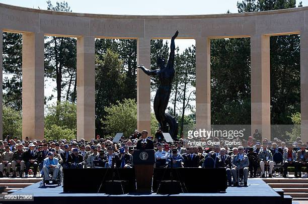 French President François Hollande and US President Barack Obama attend a ceremony held at the Memorial of the Colleville American military cemetery...