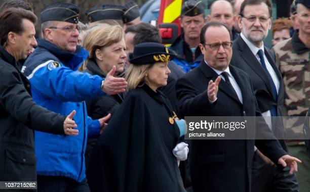 French President François Hollande German Cancellor Angela Merkel and Spanish Prime Minister Mariano Rajoy are welcomed at the temporary landing site...