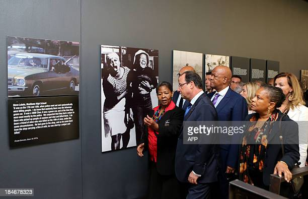 French President François Hollande listens to Antoinette Sithole sister of the first victim of the June 16 Soweto uprising Hector Pietersen at the...