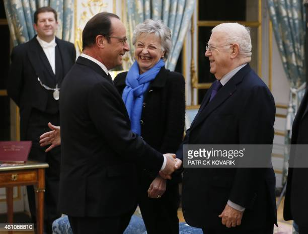 French President François Hollande speaks with members of the Constitutional Council Michel Charasse and Claire Bazy Malaurie during New Year wishes...