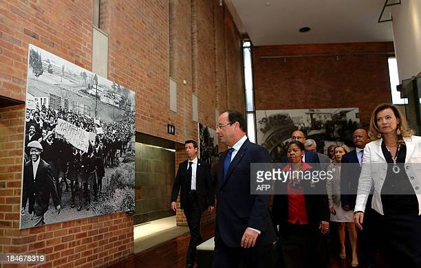 French President François Hollande walks in front of Antoinette Sithole sister of the first victim of the June 16 Soweto uprising Hector Pietersen...
