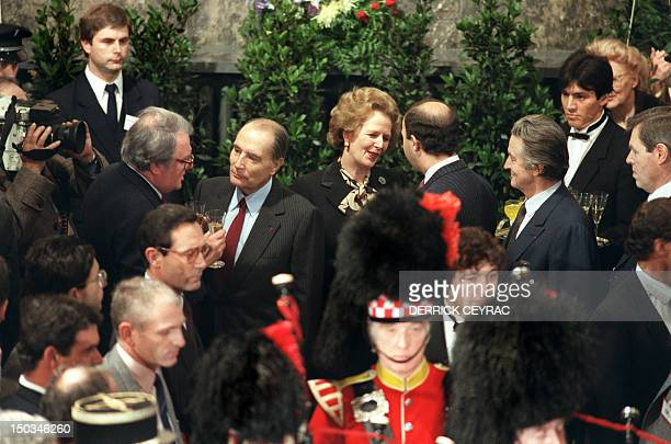 French President François Mitterrand chats with city of Lille's Mayor Pierre Mauroy and British Prime Minister Margaret Thatcher confers with future...