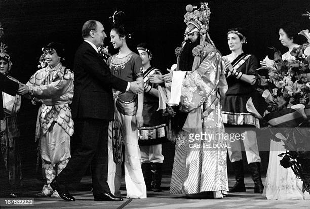 French President François Mitterrand greats the artists of the Beijing Opera compagny after attending the show on May 4 1983 at China's Great Hall of...