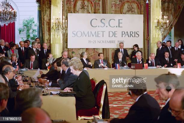 French President François Mitterrand opens the OSCE summit Organization for Security and Cooperation in Europe on November 19 1990 with the head of...