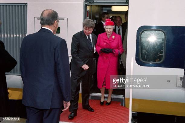 French President François Mitterrand welcomes Queen Elizabeth II during the inauguration of the Channel Tunnel on May 6 in Coquelles AFP PHOTO...
