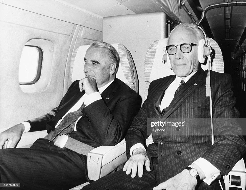 French President Georges Pompidou (left) and Airbus engineer Henri Ziegler sitting on board the Concorde airliner, circa 1976.