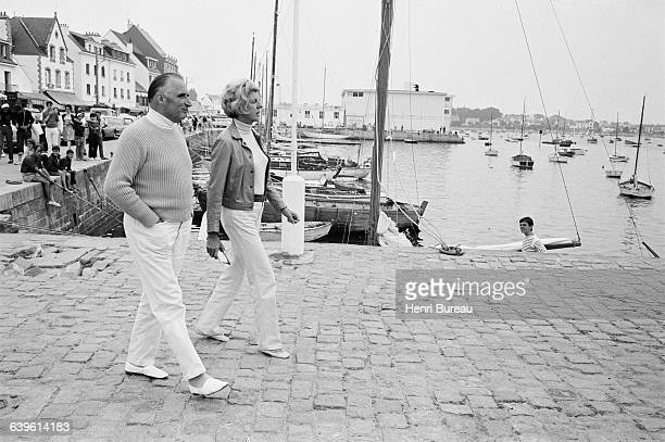 French President Georges Pompidou and his wife Claude at a port in Carnac during their vacation in Brittany