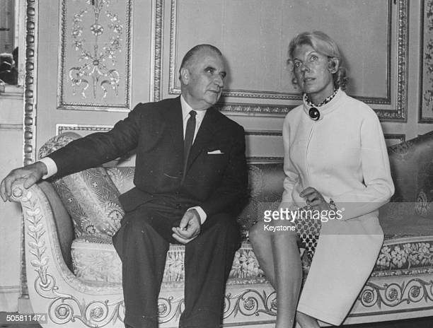 French President Georges Pompidou and his wife Claude sitting on an ornate couch together in the Elysee Palace Paris June 21st 1969