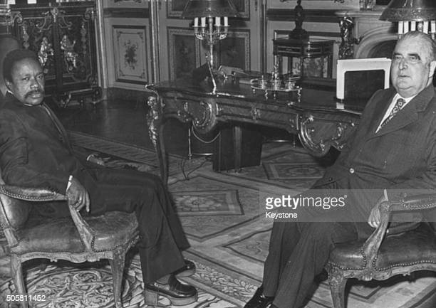 French President Georges Pompidou sitting in a meeting with Omar Bongo President of Gabon at the Elysee Palace in Paris February 18th 1974