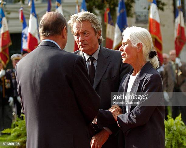 French President Jacques Chirac actor Alain Delon and Micheline ChabanDelmas third wife of Jacques Chaban Delmas share a moment during the homage to...