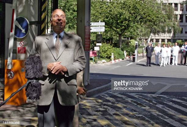French President Jacques Chirac addresses the journalist 09 September 2005 when leaving the ValdeGrace military hospital where he has been...