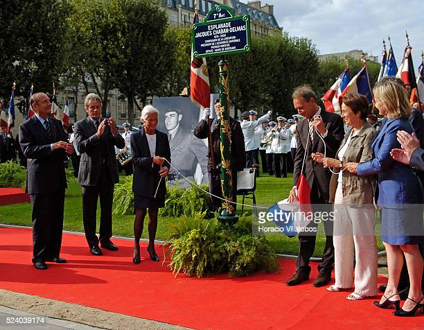 French President Jacques Chirac and French actor Alain Delon applaud while Micheline ChabanDelmas third wife of Jacques Chaban Delmas and the Mayor...