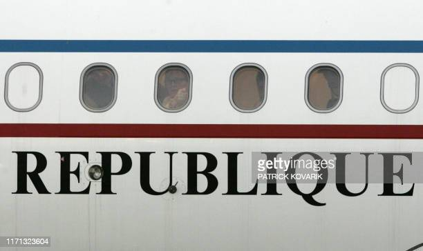 French President Jacques Chirac and his daughter Claude Chirac looks out the windows upon landing 02 December 2005 at Bamako airport on the eve of...