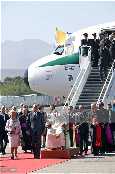 French President Jacques Chirac and his wife Bernadette Chirac walk with Pope John Paul II as he arrived at the TarbesLourdesPyrenees airport August...