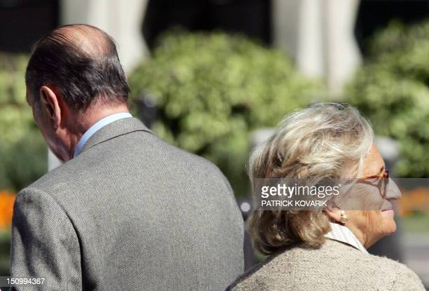 French President Jacques Chirac and his wife Bernadette leave 09 September 2005 the Val-de-Grace military hospital where he has been hospitalized for...