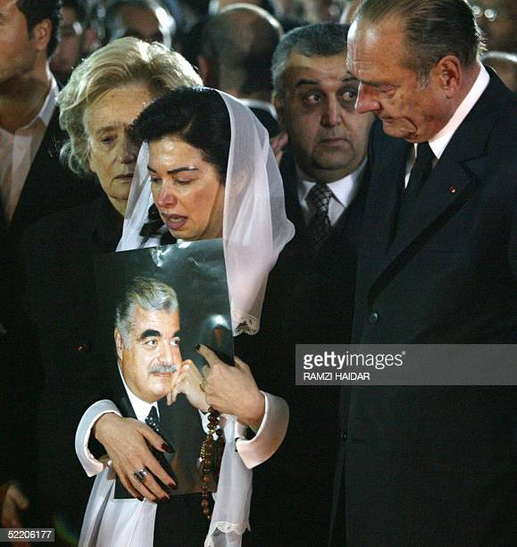 French President Jacques Chirac and his wife Bernadette visit the grave of Lebanon's slain former prime minister Rafiq Hariri with his widow Nazek in...