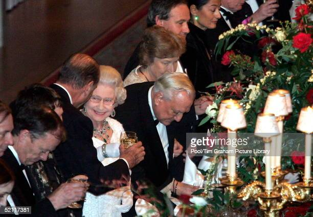 French President Jacques Chirac And Queen Elizabeth II Making A Toast Before A Dinner At Windsor Castle. Chirac's Visit To Britain Marked The...
