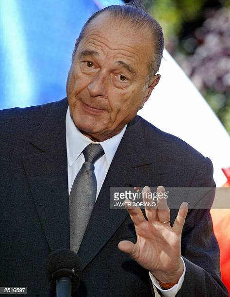 French President Jacques Chirac answers journalists' questions during a joint press conference with Spanish Prime Minister Jose Maria Aznar after...