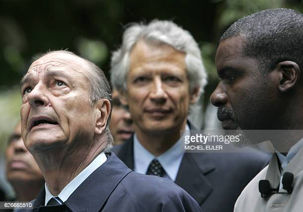 French President Jacques Chirac followed by Prime Minister Dominique de Villepin arrives in the Luxembourg Garden 10 May 2006 in Paris for a ceremony...