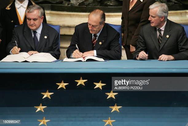 French President Jacques Chirac French Prime Minister JeanPierre Raffarin and French Foreign Minister Michel Barnier sign the Treaty and Final Act...