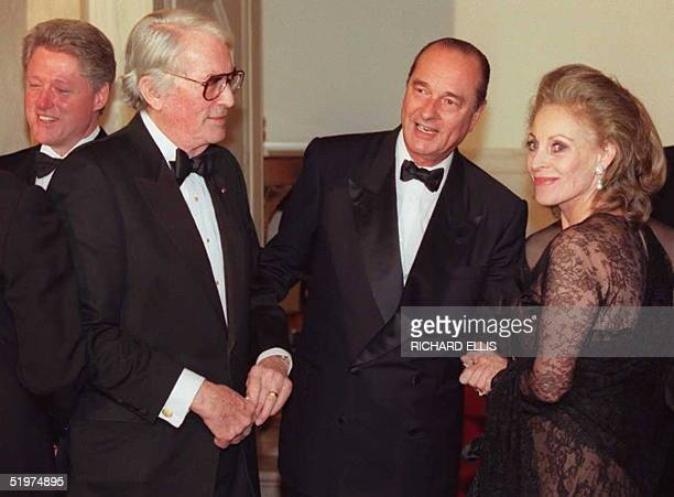 French President Jacques Chirac greets US actor Gregory Peck and his wife Veronique Peck 01 February during the receiving line before a state dinner...