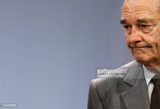 French President Jacques Chirac grimaces as he attends a press conference with German Chancellor Angela Merkel and Polish President Lech Kaczynski in...