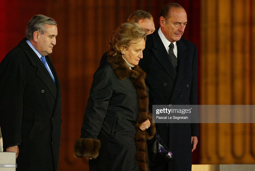 French President Jacques Chirac (R), his wife Bernadette Chirac (C), and Prime Minister Jean-Pierre Raffarin (L) attend a ceremony to transfer Dumas' ashes to the Pantheon November 30, 2002 in Paris, France. The Pantheon is the traditional resting place of the remains of France's greatest historical and cultural figures.