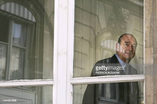 French President Jacques Chirac is seen through a window as he waits for Saad Hariri son of former Lebanon's Prime Minister Rafic Hariri 12 April...